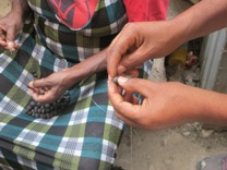 Here the beads are being strung