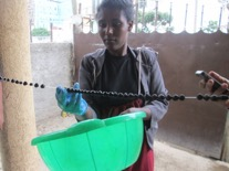 And hung to dry – Aregahegn Assefa helps one of our ladies hang the beads to dry
